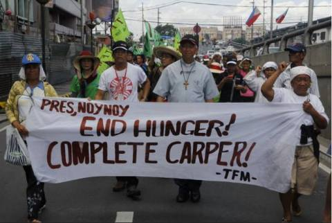 Religious leaders and landless farmers marching for the passage of HB 4296. Photo by Task Force Mapalad (TFM).